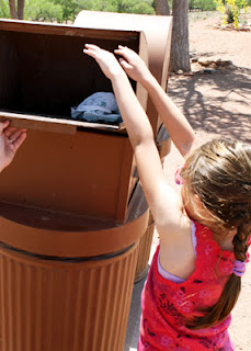 Tessa was given a small trash bag to fill with litter and correctly deposit in a trash can at Canyon de Chelly.