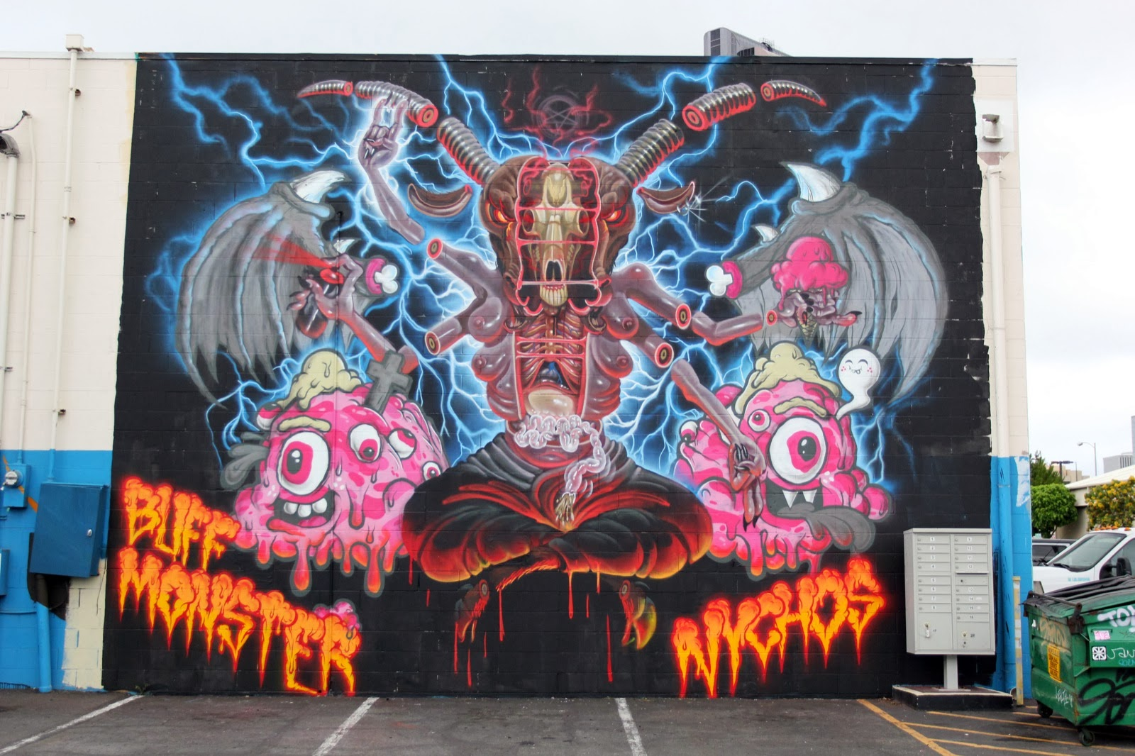 Hail Satan! While you discovered some progress shots a few days ago (covered), Nychos and Buff Monster have now wrapped up their collaboration for POW! WOW! Hawaii in Honolulu. 1