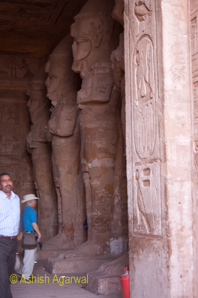 Tourists and the statues inside the Abu Simbel temple in Egypt