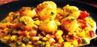 Picture of Scallops Bacon Corn Sauce in a dark plate