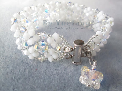 Lady_In_white_bracelet_with_butterfly_dangle_embellishment