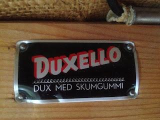 teak fåtölj märkt duxello dux med skumgummi