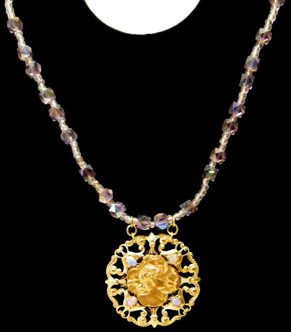 gold pendant necklace with glass beads
