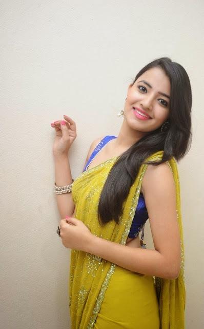 Ruksha in lovly Sleeveless Blouse Choli and Transparent Yellow Saree
