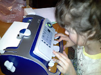 girl typing on a SMART brailler.
