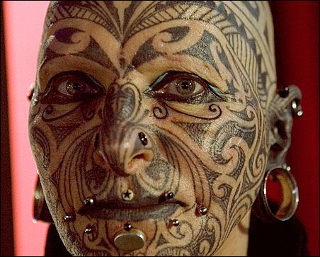 tattooed face. tattoos on face