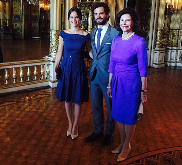 "Queen Silvia of Sweden, Prince Carl Philip and Princess Sofia of Sweden at the inauguration of ""The Lilian Look"" exhibition. The exhibition Designs for a Princess – The Lilian Look! will be on display at the Royal Palace of Stockholm."