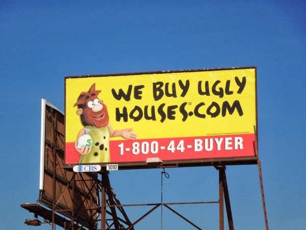 We buy ugly houses caveman billboard