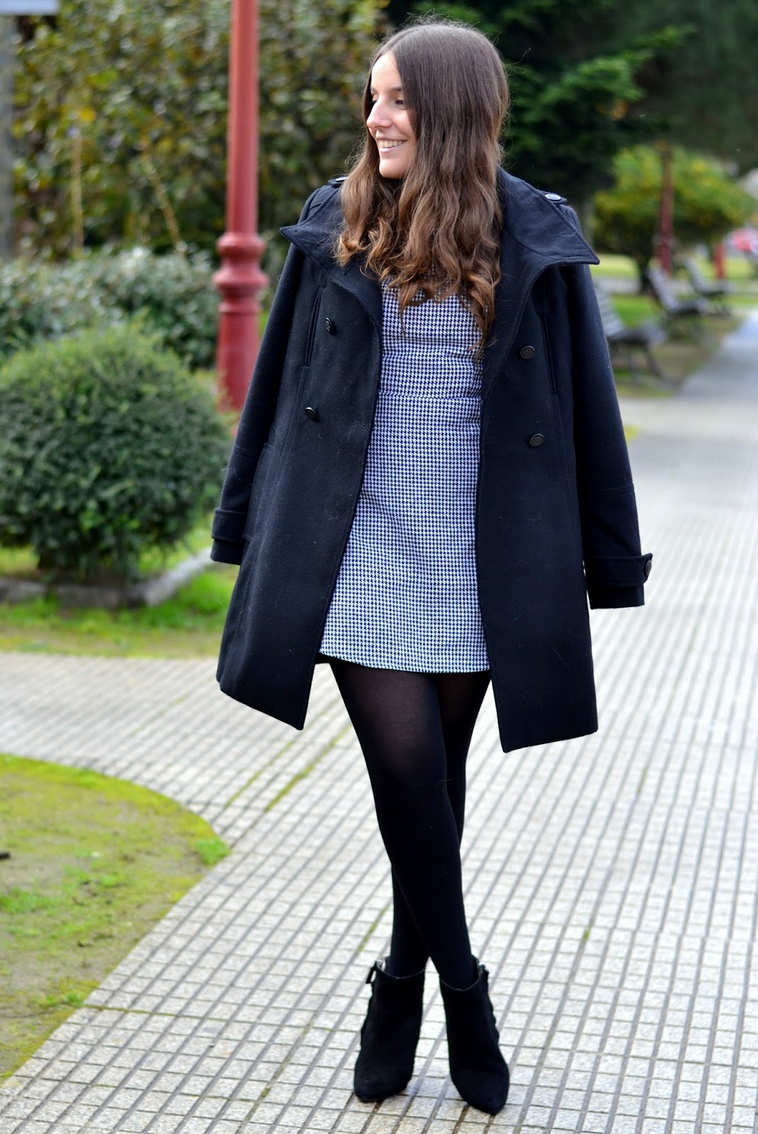 black coat and houndstooth dress