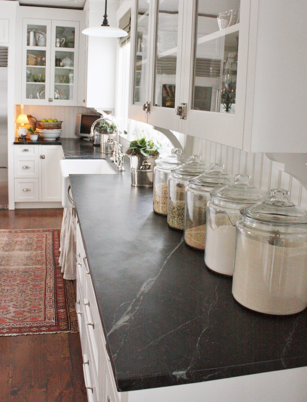 Anderson grant decorating with glass canisters in the for Kitchen counter decor