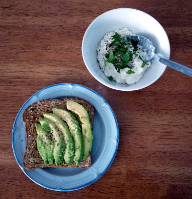 avocado toast and cottage cheese with chopped cilantro
