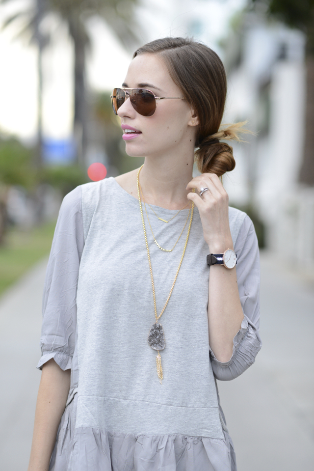 gray ruffled top with layered necklaces and aviator sunglasses, M Loves M