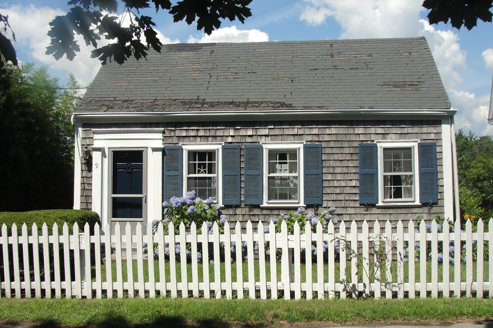 Cape cod historic homes blog charming cottage with a for Cabin cape cod