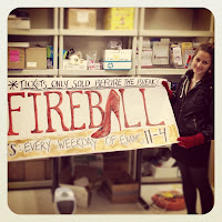 Helen holding the banner she designed to advertise ticket sales for the Fireball gala.
