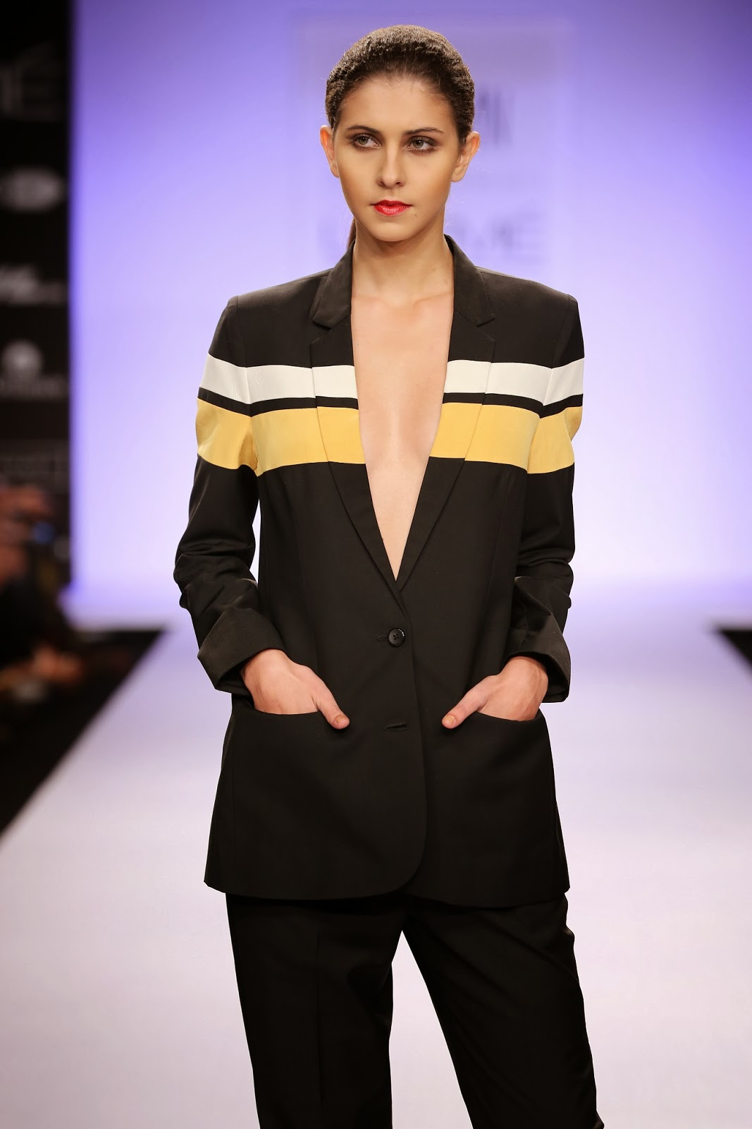 I love the sharply cut Jacket glittered with stripes to keep the theme intact. Sporty broad stripes and giant numerical motifs added to the very fun collection which was at the same time quite right for elegant evenings.