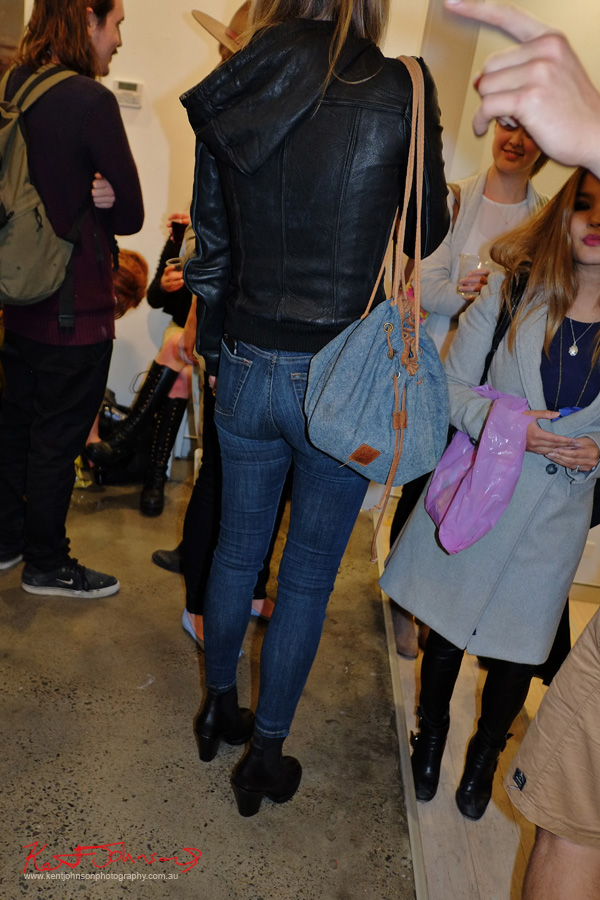 Denim jeans and bag, leather bomber jacket. Street Fashion Sydney photographed by Kent Johnson.
