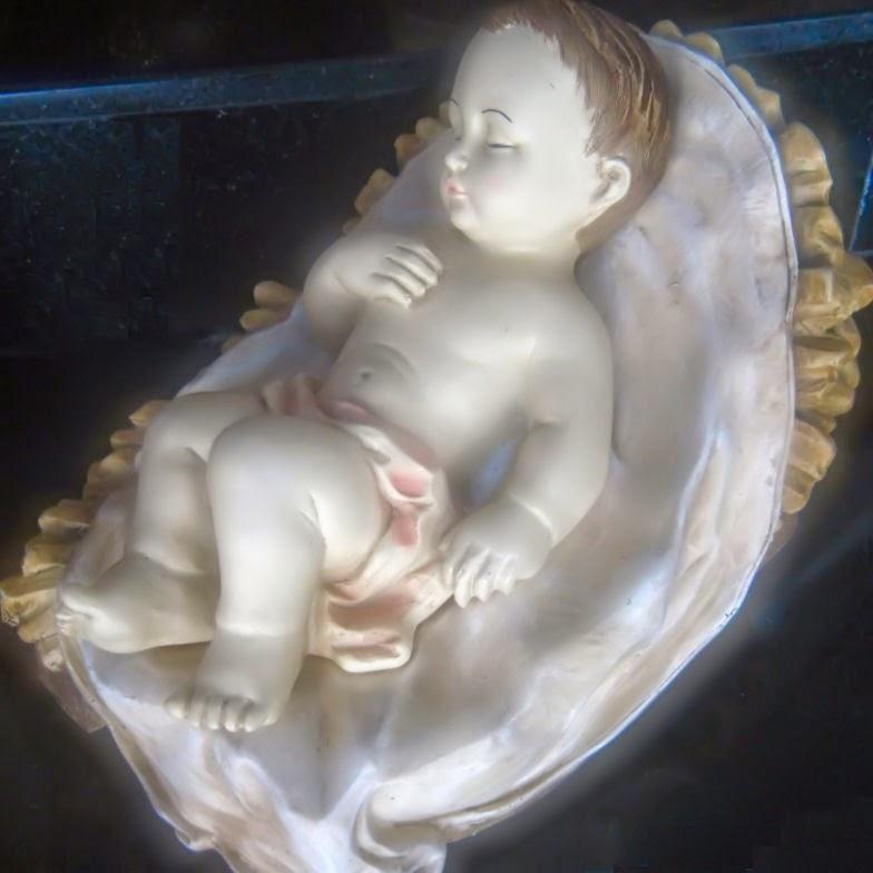 Escultura anônima sobre o Menino Jesus.