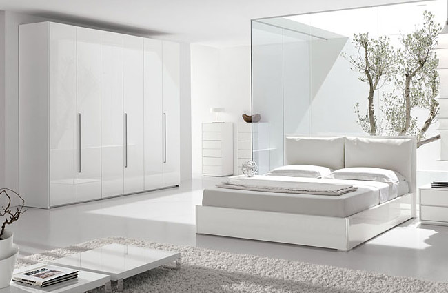 white bedroom with tree
