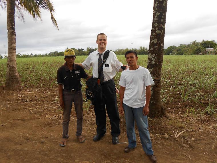 Landon with local farmers