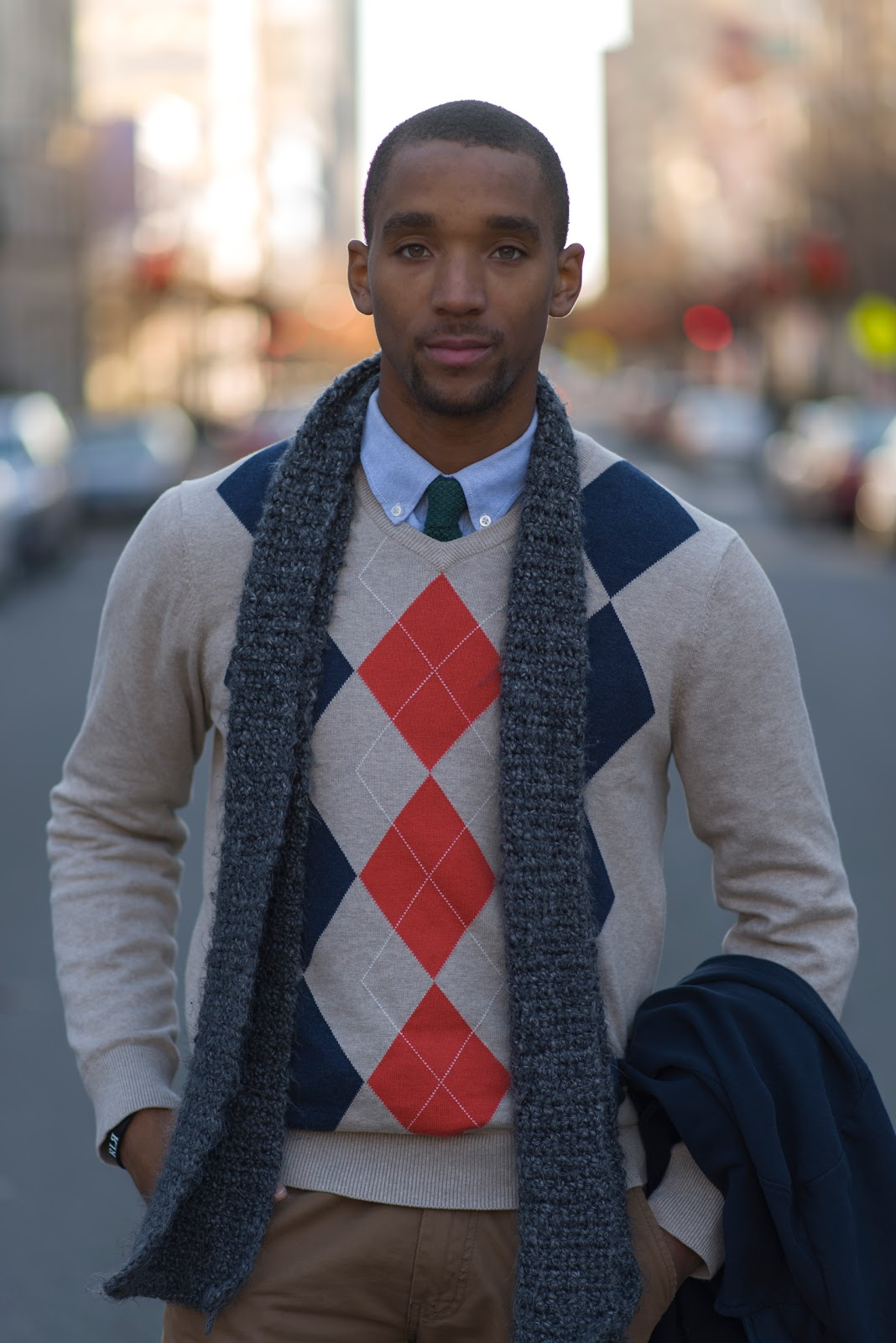 St. Augustine's University student Ronald Moore wears a tan argyle sweater over a sky blue shirt and a tie and under a navy blazer. He is also sporting brown khakis and brown penny loafers with the penny inside!