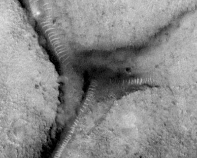 Tunnels On Mars 'A Ventilation System For Aliens Below Its Surface'?