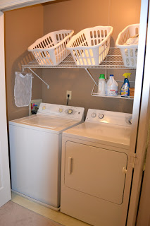 Tilted shelf in laundry room for baskets :: OrganizingMadeFun.com