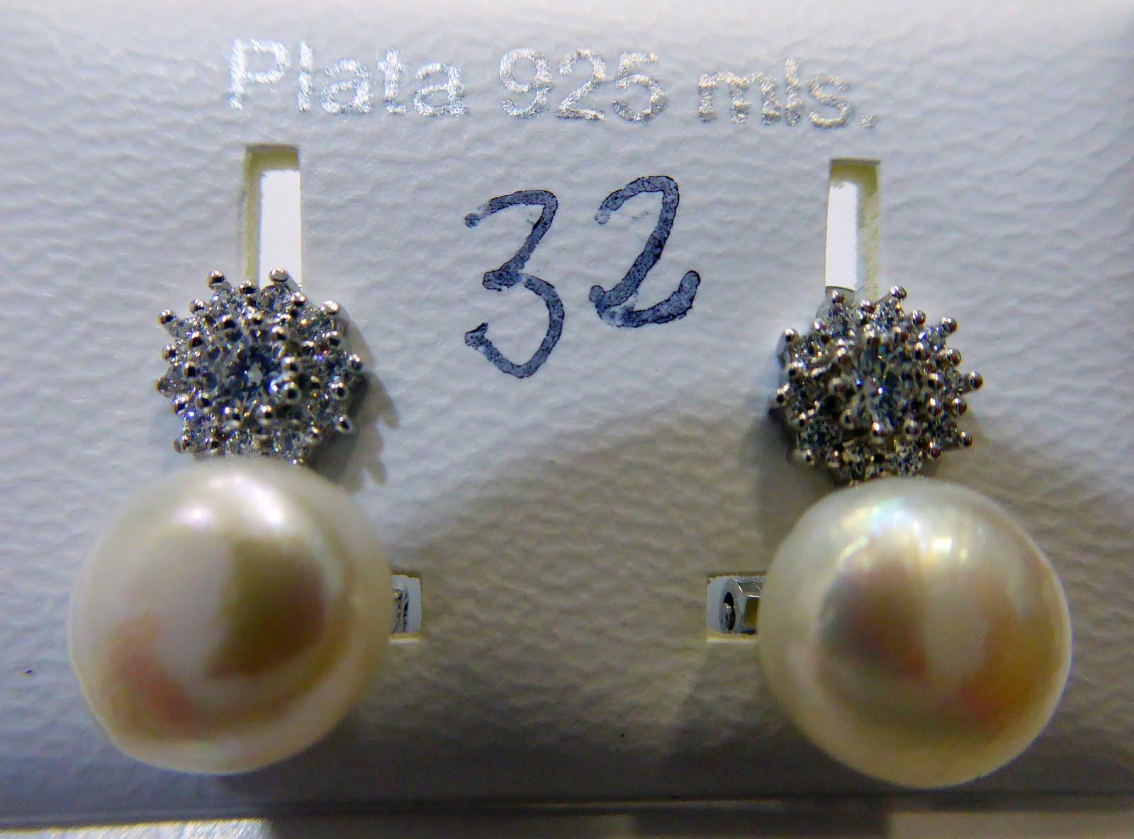 Pendientes de perla de plata con cierre omega