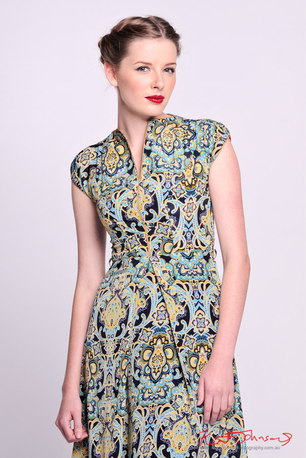 Blue-Green paisley dress with vee neckline mid shot with model - Vintage Fashion - Studio White Background -