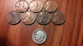 Coin Roll Hunting results 7 wheat pennies and a 1953 silver dime