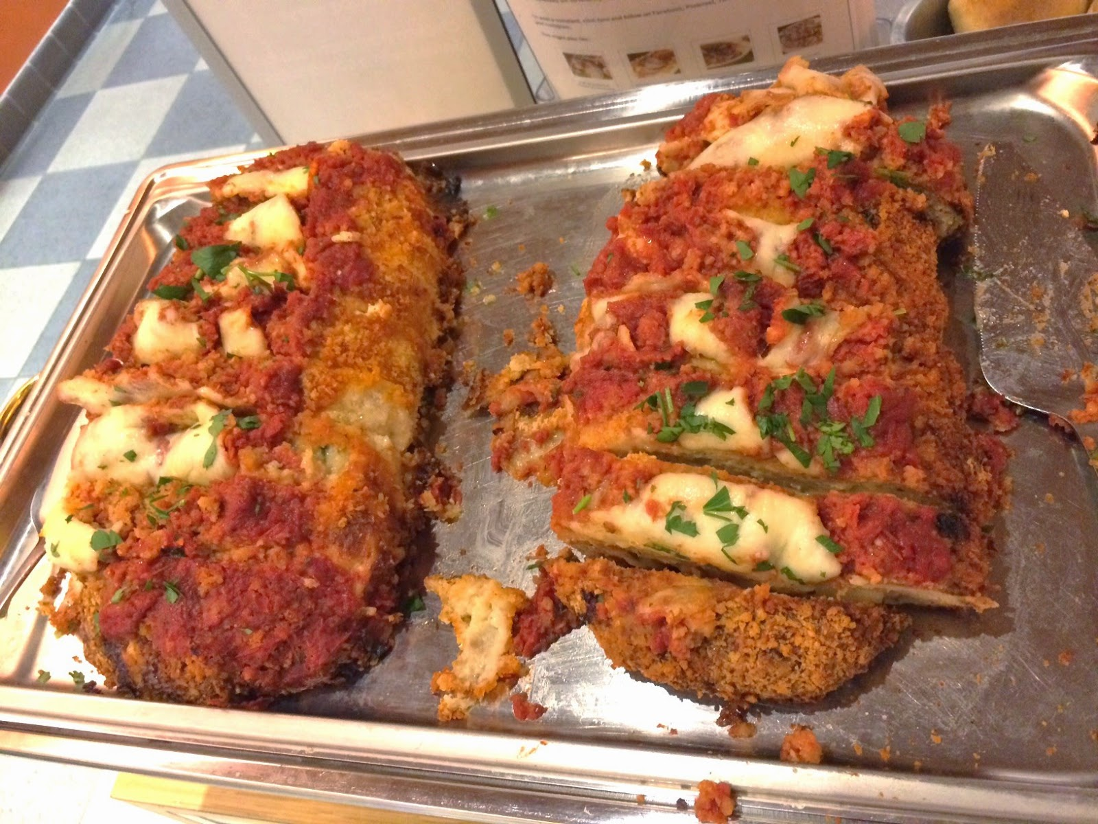 A tray of two Chicken Parmesan Meatloaf