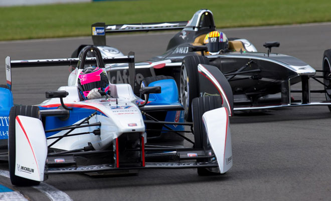 Two Formula E cars contest a corner