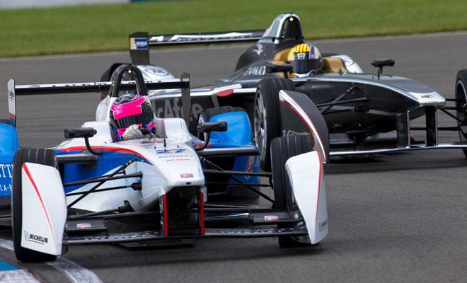 Two Formula E cars contest a corner