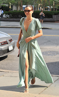 Miranda Kerr showing off her legs in a ming green dress