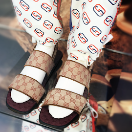 Gucci Original GG slide sandals and jogging pant.