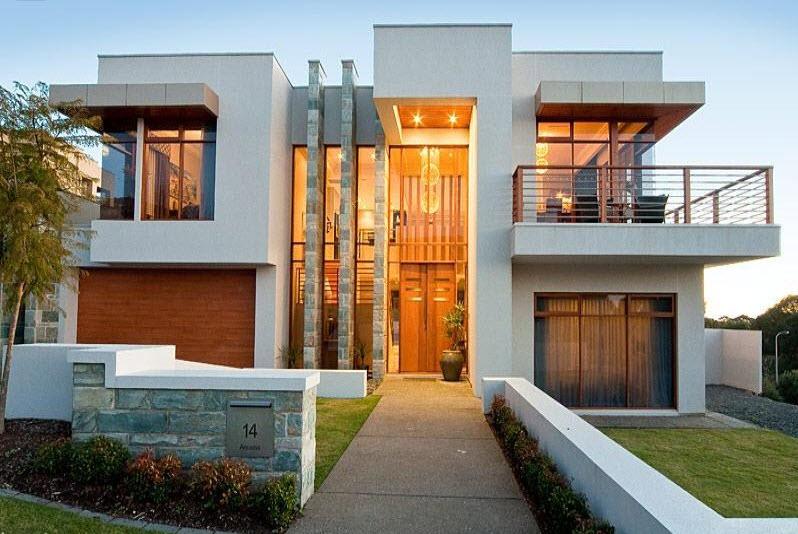 moderna casa de dos pisos con acabados en piedra y madera amplios balcones y terrazas