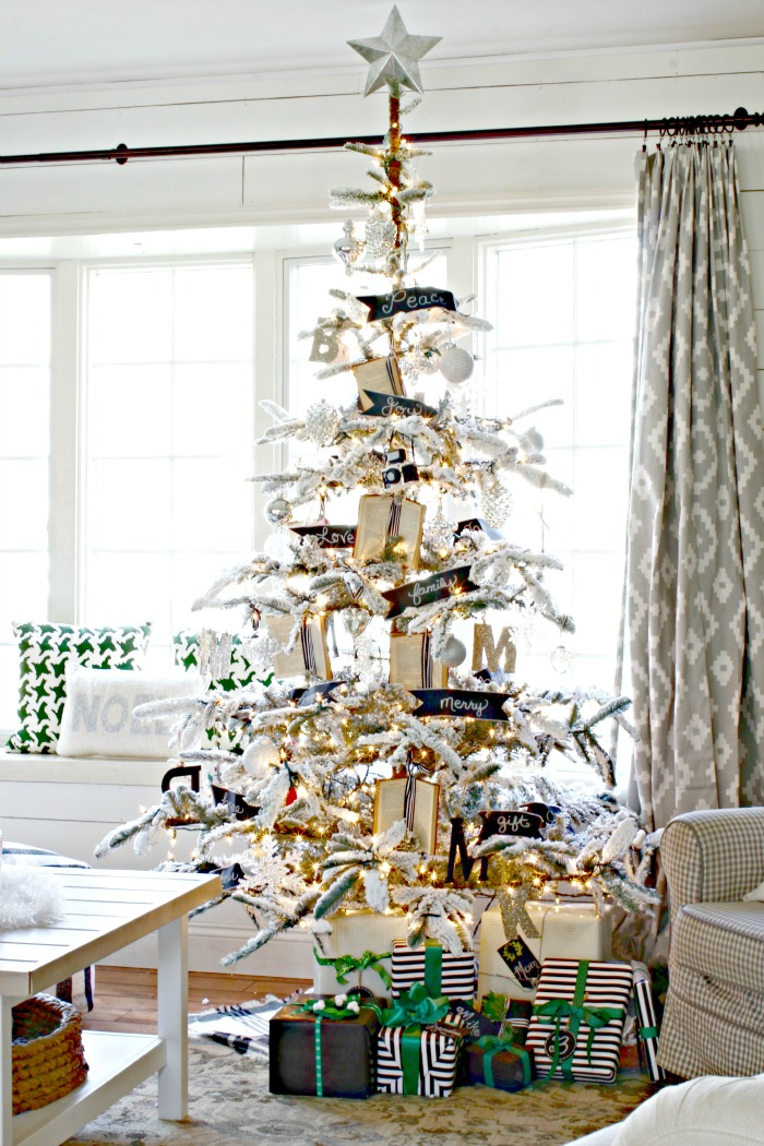 Flocked Christmas tree decorated with small books, black and white accents and mercury glass ornaments - www.goldenboysandme.com