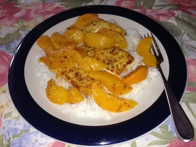 Plate of rice with tofu and peaches