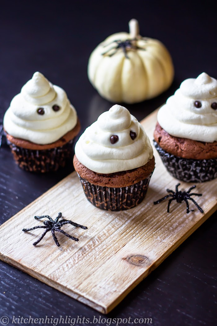 Here is a batch of delicious chocolate, scary but oh so cute, ghost cupcakes with white chocolate ganache frosting
