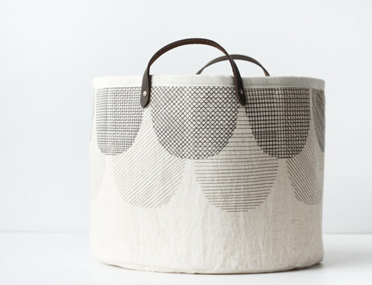 pale fabric basket with leather handles