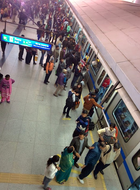 Delhi's Rajiv Chowk emerged on Monday as a key battle ground for AAP and anti-AAP forces on social media.   There was a tense anticipation on how Rajiv Chowk, a key node on Delhi Metro, would hold up on Monday, the first working day Delhi's odd/even scheme.   A photo, which showed a completely jam-packed Rajiv Chowk went viral.
