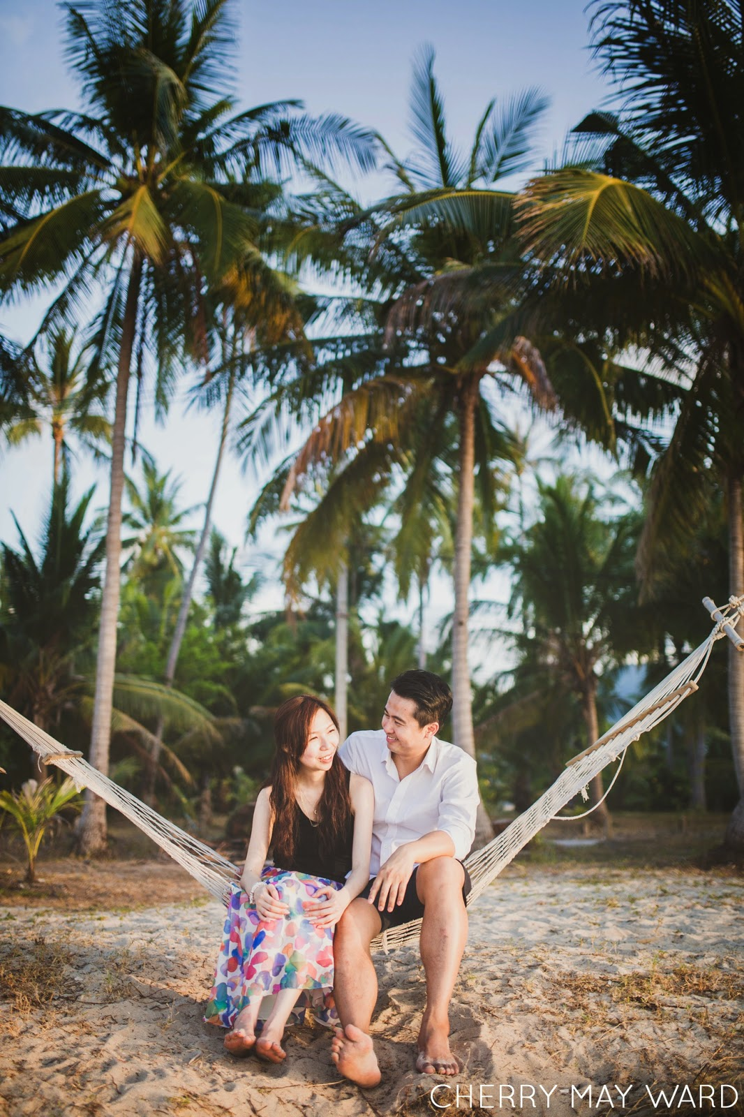 couple sitting in a hammock on the beach, Ban Tai beach engagement session, Samui engagement photographer, Koh Samui wedding and couples photographer