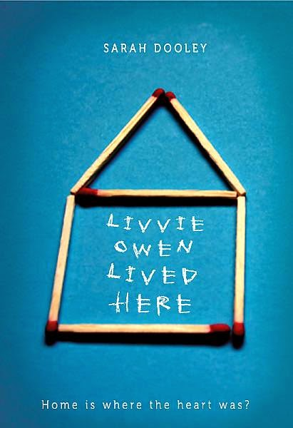 Book cover: Livvie Owen Lived Here by Sarah Dooley. Image depicts matchsticks arranged to form the outline of a house