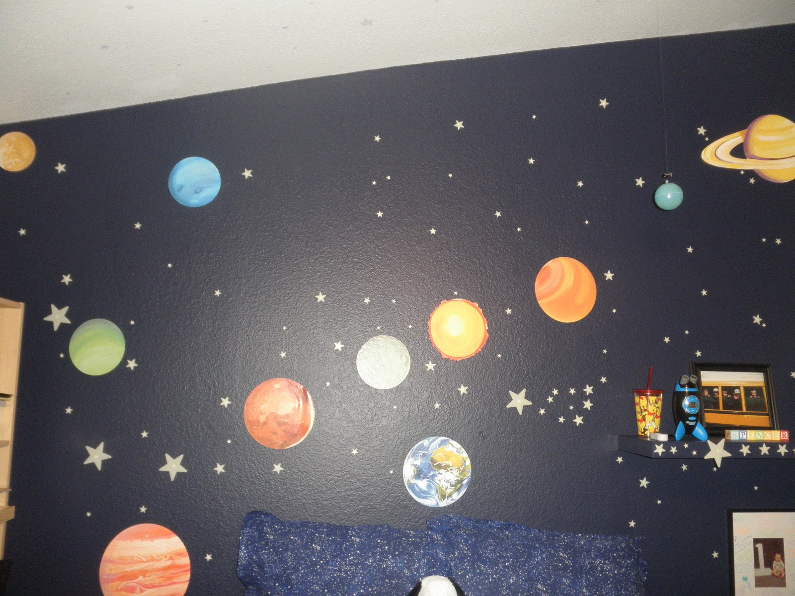 a beagle and a baby this is our outer space bedroom a close up of the bed i just love this bedding i took a 3 hour nap in spencer s bed on tuesday don t worry michael was home the kids were safe and