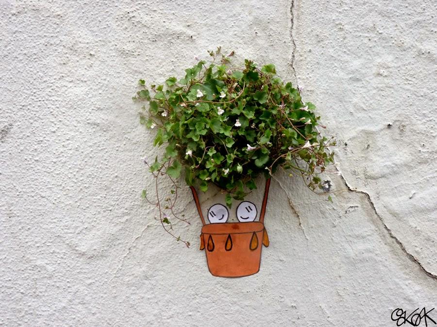 23-We-are-Free-OakOak-Street-Art-Drawing-in-the-City-www-designstack-co