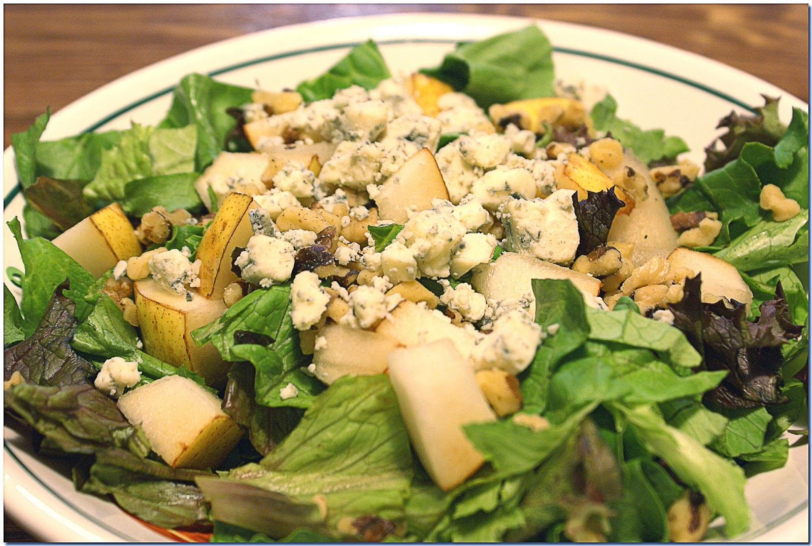 ... the pears, gorgonzola, and walnuts over the salad before serving