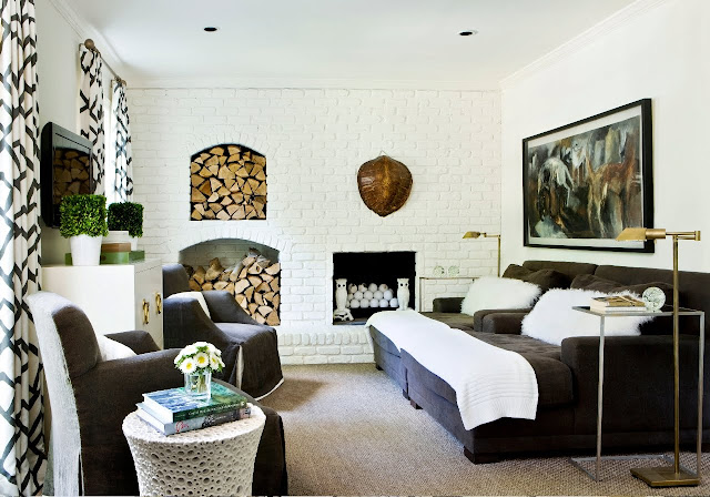 family room with a seagrass rug, the white painted brick fireplace and the huge oversized lounge love seats and two matching arm chairs