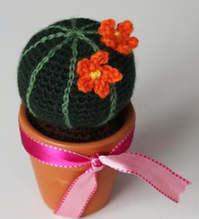 http://www.craftsy.com/pattern/crocheting/home-decor/round-cactus-english/52052