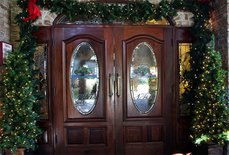 gorgeous stained glass and wood doors greet you as you enter the lobby - Glass Front Hotel Decoration
