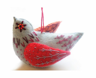 Felt christmas decoration with hand embroidery