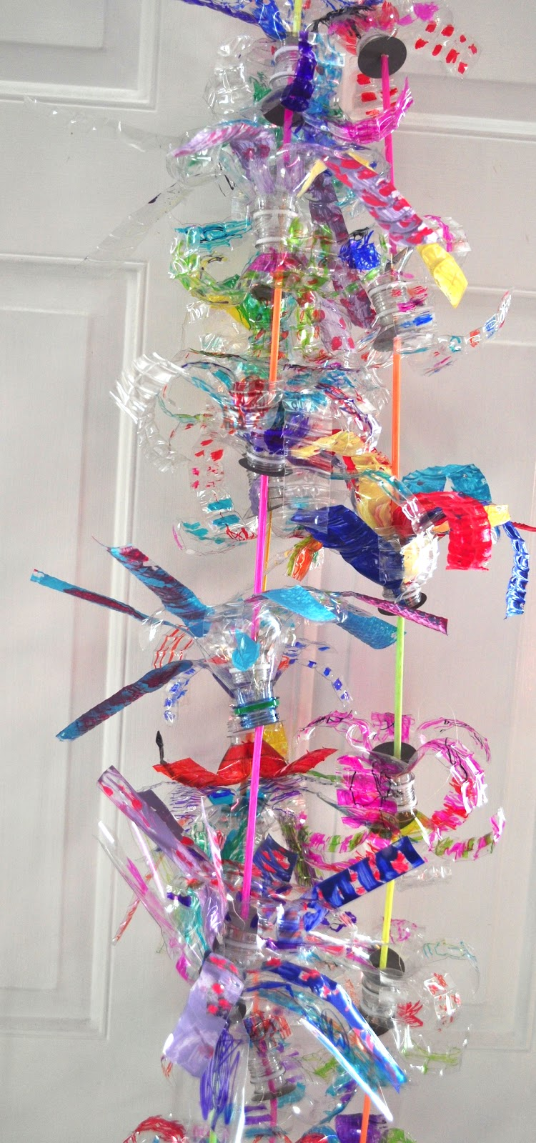 Art with kids recycled flower water bottles for Recycled flower art